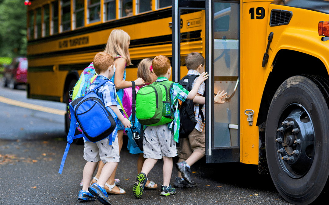 Children getting onto a bus | Wiers Fleet Parnters